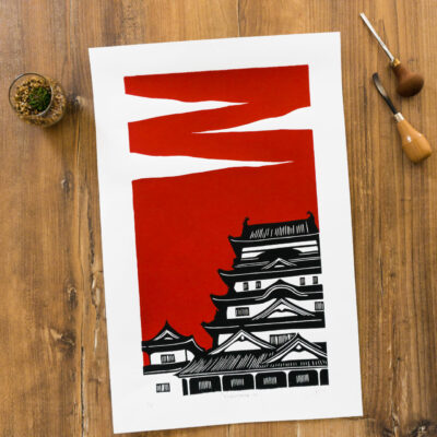linogravure du château de fukayama au japon sur fond rouge